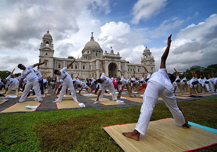 A Yoga instructor seen giving direction at a Yoga Exercise during the International Yoga Day. India Tourism organised the Yoga session at iconic Victoria Memorial ground in the morning. Yoga is a Physical & Spiritual practice originated from India during Ancient ages which is now recognized by United Nations also.