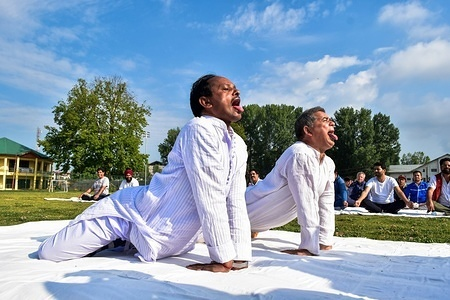 Participants perform yoga during a mass yoga session on International Yoga Day in Srinagar, Kashmir. Hundreds of Yoga Practitioners participated in Mass Yoga function to mark the International Day of Yoga in Srinagar. The  Yoga Day, is celebrated annually on June 21 since its inception in 2015.