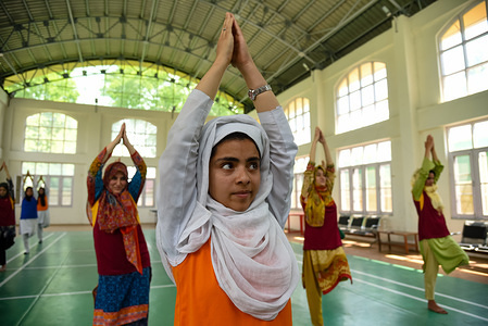 Kashmiri students perform Yoga in a college during the International Yoga Day in Srinagar. Since the United Nations declared June 21 as International Yoga Day in 2014, it has been observed every year to mark its significance in one's lifestyle.