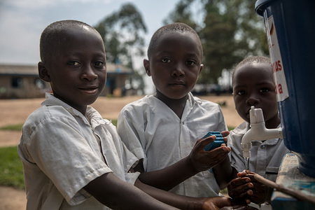 Children wash their hands with chlorinated water at a primary school as part of a preventive initiative aimed at halting the spread of Ebola in Beni. The DRC is currently experiencing the second largest Ebola outbreak in recorded history, and the response is hampered by it being in an active conflict zone. More than 1,400 people have died since August 2018.