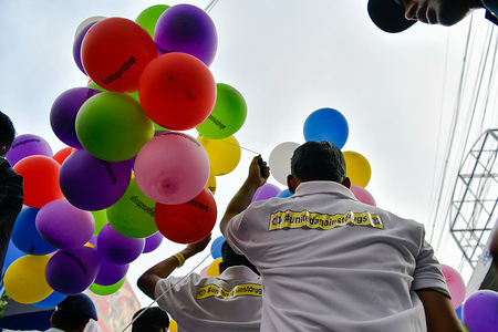 Participant holds colourful balloons during the rally. United against drugs rally organized by Kolkata police to observe the international day against drug abuse and illicit trafficking in Kolkata.