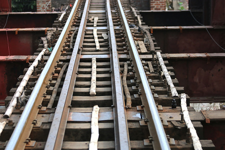 Bamboo was used instead of iron on the railway tracks in a section of a railway bridge in Dhaka.  This is a high-risk factor for the train commuters.