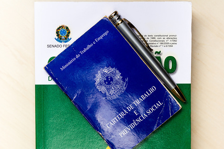 In this photo illustration, a Work Permit and Social Security (CTPS) booklet in Glória de Dourados. The work permit is one of the only document that clarifies and proves data on the functional life of a worker.