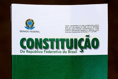 "This photo illustration shows a constitution booklet in Glória de Dourados. The Constitution is the fundamental and supreme law of Brazil, serving as a parameter of validity to all other normative species, standing at the top of the legal system. It was known as the ""Citizen Constitution,"" because it was conceived in the process of democratization, which began with the end of the military dictatorship in Brazil (1964-1985)."