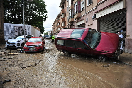 Cars that were dragged during the flood seen on in the street, after the disaster. Floods caused by the meteorological phenomenon called DANA, Isolated Depression in High Levels that resulted in an increase of the water level of the River Cidacos by 4 meters in ten minutes.