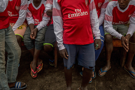 Former child soldiers pose for a photo dressed in Arsenal Fly Emirates jerseys at a Transit Centre in Goma.Hundreds will spend several months here before being reintegrated into the community. UNICEF is working with MONUSCO (UN DRC stabilization mission) to support some of the tens of thousands of child soldiers that have been recruited in eastern DRC since 2013.
