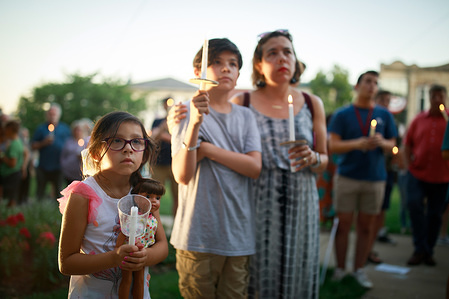 Protesters gather for the Lights for Liberty: A Vigil to End Human Detention Camps rally and candlelight vigil on the steps of the Monroe County Courthouse in Bloomington. United States President Donald J. Trump says ICE will conduct raids against undocumented immigrants in American cities over the weekend.
