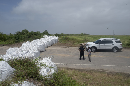 Sandbags and barricades erected throughout New Orleans and the surrounding areas during the preparations. New Orleans and other parts of the Gulf of Mexico prepare for the Tropical Storm Barry to make landfall, bringing with it a catastrophic rainfall. With the Mississippi River's water level at an all-time high and a storm forming in the Gulf of Mexico that is expected to make landfall on the Louisiana and Texas coasts, many fear that levees will fail and that New Orleans will again be inundated as bad as it was in the 2004 aftermath of Hurricane Kartina.