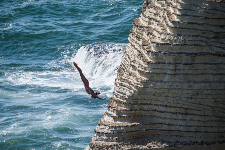 Mexican diver, Adriana Jimenez jumps from 22m at Rauche Rocks, during the competition. Part of a RedBull sponsored world tour, high divers from all over the globe are taking part in cliff jumping from a scenic location on the planet. Jumping from heights ranging from 20m they encountered strong winds and rough seas.
