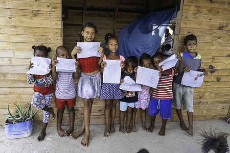 Children seen showing their drawings at Fundazion Corajem in La Boquilla Cartagena. Fundacion CoraJeM works in educating and  creating opportunities for the people in need. Teaching them culture and values, it allows them to build up a better future and live with more dignity.