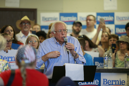 Senator Bernie Sanders, who is running for the Democratic nomination for President of the United States, speaks to supporters during the opening of the Council Bluffs office for his campaign.