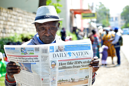 A man affected by the post poll violence reads newspapers after hearing of the main case to seek compensation was suspended pending confirmation of the status of the IDP's governing board. The government has been blamed for irregularly compensating fake IDP's and leaving innocent ones with nothing. The over 100, 000 people affected by Kenya's post-election violence have been languishing in poverty for years as they wait for compensation from the government. Kenya 2007-2008 post poll violence led to death, forced displacements and destruction of poverty.