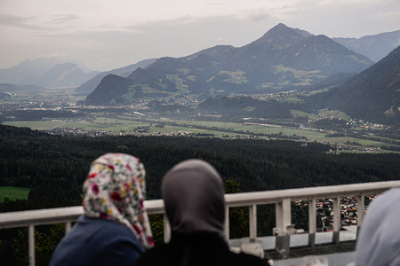 Muslim women admire the Landscape from a Kanzelkehre viewpoint.  Tyrol is a western Austrian state located in the Alps known for its ski resorts, trekking trails and  historic locations.