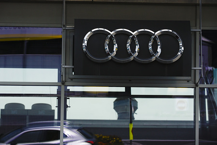 Audi logo is seen at a vehicle showroom.  Tyrol is a western Austrian state located in the Alps known for its ski resorts, trekking trails and  historic locations.