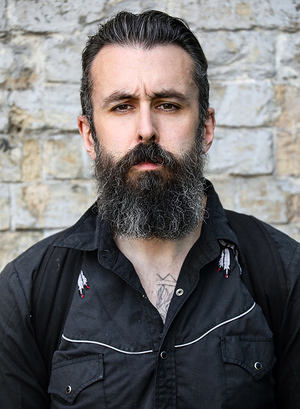 Scroobius Pip (David Meads) attending the opening night of Barber Shop Chronicles at the Roundhouse in London