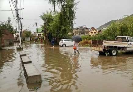 Residents wade during the heavy rains in Srinagar. Heavy rains caused water-logging in many areas of Srinagar exposing the poor drainage system of the city. The weather department has predicted more precipitation in many parts of the valley in the next 24 hours.
