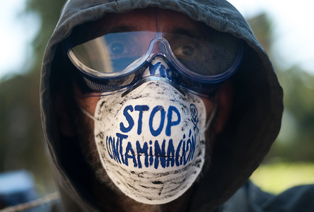 "A pro climate activist poses with a mask that says: ""Stop pollution"" during a protest to demand the climate emergency statement. Under the slogan: ""Alianza por el clima"" (Alliance for the climate), members of climate movement 'Extinction Rebellion' and social organizations against the climate change have protested in favour of politics to stop the climate change and declare the climate emergency state."