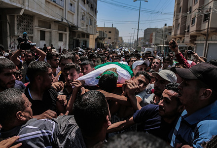 "(EDITOR'S NOTE: Image depicts death) Palestinian mourners carry the body of Ahmed Mohammed, during the funeral procession. Palestinian, Ahmed Mohammed al-Qara, 23 received his last farewell in the southern Gaza Strip town of Khan Yunis, he was wounded by a live bullet in the abdomen during the ""Al-Awda al-Kobra"" demonstration in Khan Younis on 26th Jul 2019."