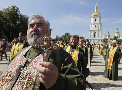 A Military chaplain (priest) of the Ukrainian Orthodox Church holds an icon during a procession in Kiev. Orthodox believers mark the 1031th anniversary of Kievan Rus Christianization or the Day of the Baptism of Kievan Rus. Thousands of believers took part at the religious procession was organized by the Ukrainian Orthodox Church in Kiev, Ukraine.