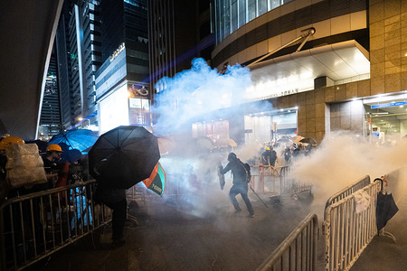 A demonstrator escapes as riot police fire multiple rounds of tear gas canisters against him during the protest. Tens of thousands of pro-democracy protesters marched in central Hong Kong in yet another round of anti government demonstration. Riot police has used tear gas and rubber bullets against protesters despite the fact that the police force has been widely commended by the public for their disproportionate use of force against the protesters in past demonstrations triggered by the controversial extradition bill put forward by the Hong Kong government.