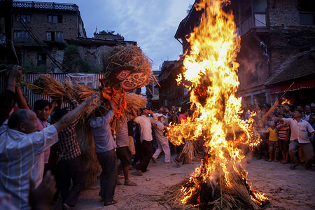 Nepali men carry the effigy of the demon Ghantakarna around a fire before setting it ablaze to symbolise the destruction of evil during the Gathamuga or Ghantakarna festival. Nepalese believe that the festival wards off evil spirits, and brings peace and prosperity.