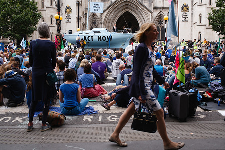 Members and supporters of climate change activist group Extinction Rebellion take part in the opening day of the group's 'Summer Uprising' demonstration outside the Royal Courts of Justice in London. Demonstrations were also held in Bristol, Cardiff, Leeds and Glasgow. Among their demands for greater action on climate change, protesters are calling for 'ecocide' (i.e. the destruction of ecosystems) to be made a criminal act. The centrepiece of the London protest, a blue boat, the 'Polly Higgins', is named after the late environmental lawyer and campaigner for the criminalisation of ecocide who died in April this year, age 50.