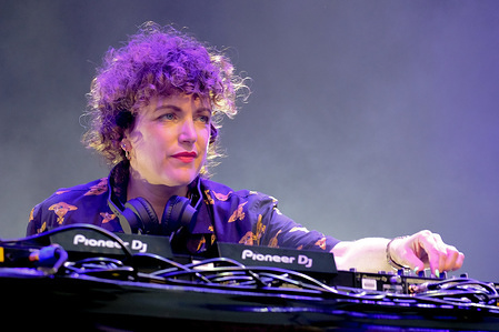 Irish DJ  and BBC electronic dance music radio 1 show host Annie MacManus , aka Annie Mac, performing DJ set live on stage at Camp Bestival , family music and arts festival.