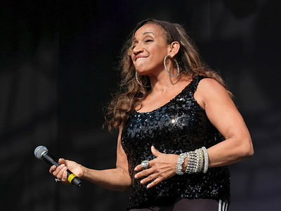Kathy Sledge, one of the original female vocalists  and founding member with Grammy Award winning American musical vocal group Sister Sledge, performing live on stage at Camp Bestival family music festival in Lulworth, Dorset, UK.