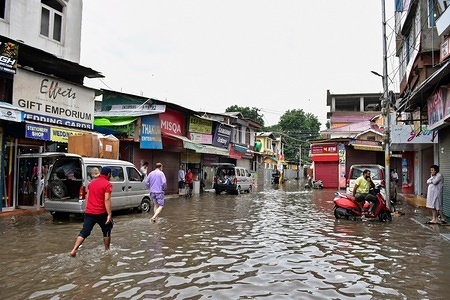 Residents wade after the heavy rains in Srinagar. Rains caused water-logging in many areas of Srinagar exposing the poor drainage system of the city. The weather department has predicted heavy rainfall for next few days all over the region.