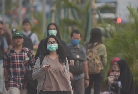 A woman wearing a mask walks on the streets of Jakarta. Jakarta has lately been at the top of the list of cities with the worst air quality in the world, President Joko Widodo urged the Jakarta government to switch to electric mass transportation in an effort to reduce emission of air pollutants in the city.