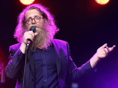 Canadian folk singer Ben Caplan from Halifax, Nova Scotia. performs on Day One of the World renowned Cambridge Folk Festival at Cherry Hinton Hall, Cambridge.