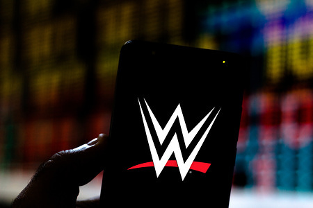 In this photo illustration the World Wrestling Entertainment (WWE) logo is seen displayed on a smartphone.