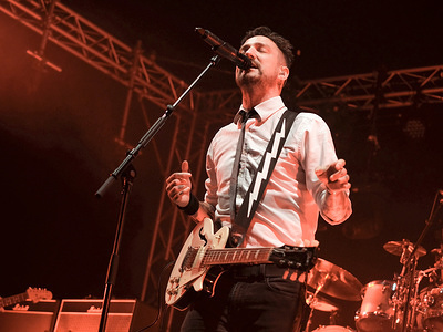 Award winning British political, folk and punk singer songwriter and guitarist Francis Edward Turner aka Frank Turner, performs with band The Sleeping Souls at Wickham festival day 3 live on stage in his home county, Hampshire.