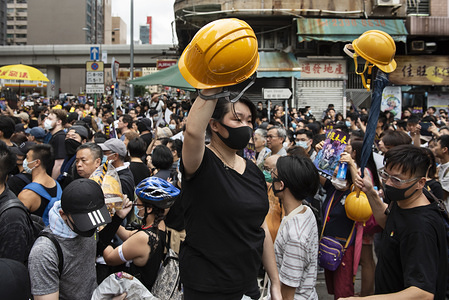 """Volunteers give away helmets to the protesters. Despite the Hong Kong government's efforts to calm the situation by declaring the extradition bill is """"dead"""", thousands of protesters still took part in anti-government protests in different areas of Hong Kong. Multiple clashes between protesters and the police have been reported and a large number of protesters have been arrested by the police."""
