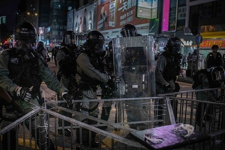 """Riot police agents dismantle barricades during the protest. Pro-democracy protesters have continued weekly rallies on the streets of Hong Kong against a controversial extradition bill since June 9, as the city plunged into crisis after waves of demonstrations and several violent clashes. Hong Kong's Chief Executive Carrie Lam apologised for introducing the bill and declared it """"dead"""", however protesters have continued to draw large crowds with demands for Lam's resignation and completely withdraw the bill."""