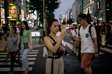 A traveller takes selfies at the Shinjuku in Tokyo. Tokyo is Japan's capital and one of  the world's most populous metropolis.