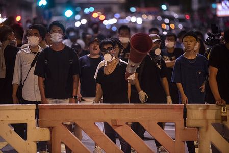 Protesters built road blocks near the police station during the demonstration. Thousands of protesters surrounded the Sham Shui Po district police station to demand the release of the student union president Keith Fong Chung Yin who was arrested for buying a torch-like laser pointer which the police consider it as weapons, sparking the latest confrontation between the protesters and the police.