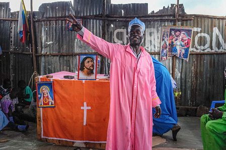 Preacher man at a local Church in Kibera. The traditional beliefs and practices of African people are a set of highly diverse beliefs that include various ethnic religions. Many Kenyans have started their own churches, which feature a blend of Christianity and traditional religion, with the aim of fighting and blessing through the ritual spiritual beliefs. Churches begin prayer services at exactly nine in the morning to three pm in the afternoon each Sunday and aim at transforming believers through prayers and the Holy Spirit. Each church carries about twenty to thirty servants.