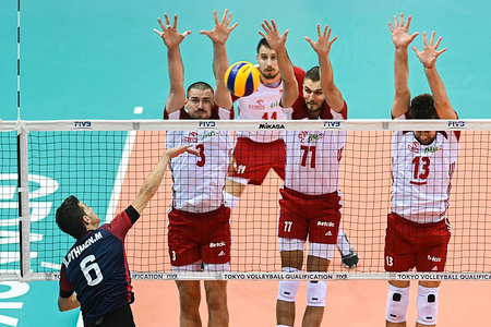 Dawid Konarski (L) Karol Klos (C) and Michal Kubiak (R) from Poland are seen in action during Men's Olympics Qualifiers Tournament Pool D match between Poland and Tunisia. (Poland beat Tunisia : 3-0)