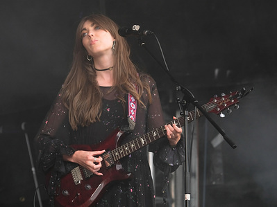 Emillie Key with English contemporary family alternative folk trio Wildwood Kin performs live on stage at Cropredy Festival  in Banbury.