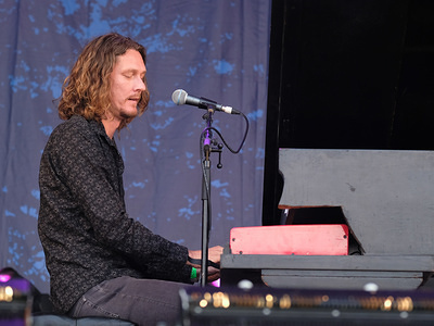 Keyboardist and guitarist for Ozzy Osbourne's band, Adam Wakeman performs live on stage at the Cropredy Festival in Banbury.