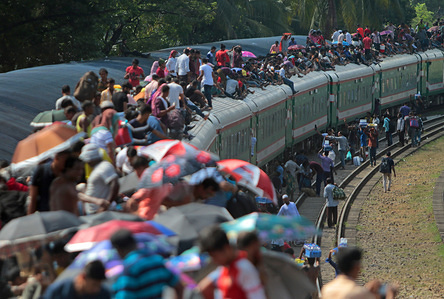 People cram onto a train to travel back home to be with their families ahead of the Muslim festival of Eid al-Adha in Dhaka. Muslims around the world celebrate Eid al-Adha, the sacrificial festival, which marks the end of the Hajj pilgrimage to Mecca and commemorates Prophet Abraham's readiness to sacrifice his son to show obedience to Allah.