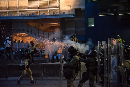 Riot police fire tear gas at protesters during a protest against the government. Protesters took to the streets in yet another round of anti-extradition marches. Police fired dozens of rounds of tear gas and rubber bullets in clashes with protesters, while residents and bystanders were also caught in the crossfire at various locations. Anti-government protesters continued their weekend marches despite government warnings labeling the protests as illegal. The Hong Kong government has yet to cave to any of the protesters demands, including the demand to fully withdrawal the controversial extradition bill.