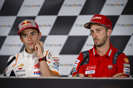 Repsol Honda Team's Spanish rider Marc Marquez (L) and Ducati Team's Italian rider Andrea Dovizioso attend a press conference after the qualifying session of the Austrian MotoGP Grand Prix.