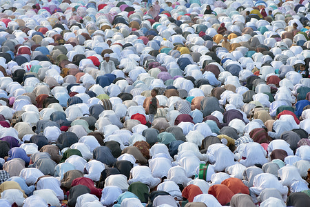 Indonesian Muslims perform Eid Al-Adha prayers a near Koinonia church on street of Jakarta. Eid al-Adha is the biggest celebration for Muslims in all over the world after Eid al-Fitr to commemorate the willingness of Ibrahim (also known as Abraham) to follow Allah's (God's) command to sacrifice his son.