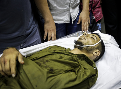 (EDITOR'S NOTE: Image depicts death) The body of a Palestinian fighter, Marwan Naser aged 25 at the hospital morgue in Gaza. Israeli soldiers fired at a Palestinian fighter at the Gaza border on 11 August, according to the Israeli military. Palestinian medics said the fighter was killed at the northern Gaza Strip. It was the second such incident since 10 August, when Israeli troops shot dead four Palestinians fighters who attempted to cross the volatile border in the eastern Gaza Strip.