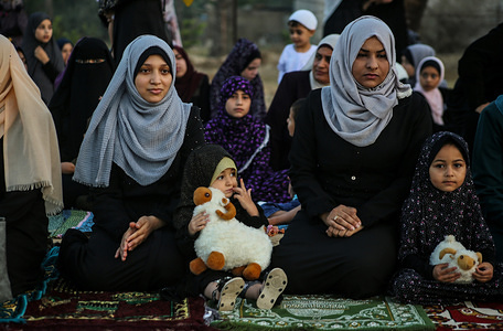Palestinian children attend prayers during the Eid al-Adha festival in Gaza. Eid al-Adha is the biggest celebration for Muslims in all over the world after Eid al-Fitr to commemorate the willingness of Ibrahim (also known as Abraham) to follow Allah's (God's) command to sacrifice his son.
