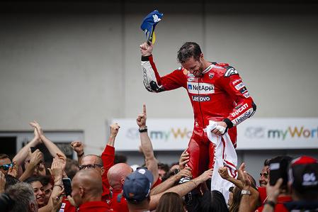 Ducati Team's Italian rider Andrea Dovizioso celebrates after winning the Austrian MotoGP Grand Prix race.