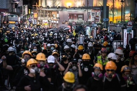 Protesters preparing to march to the police headquarters in Tsim Sha Tsui during the demonstrations. Police agents and protesters clash in Nathan Road, Tsim Sha Tsui. A total of 35 people were arrested when Protesters took to the street to demonstrate against the government, they demand the complete withdraw of the extradition bill, and for the government to set up an independent inquiry into the recent clashes between protester and police. Police fired tear gas in response to another weekend of protests.