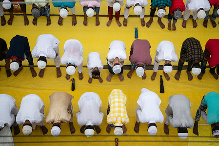 Muslims offer Eid al-Adha prayers in Kolkata. Eid al-Adha is the biggest celebration for Muslims in all over the world after Eid al-Fitr to commemorate the willingness of Ibrahim (also known as Abraham) to follow Allah's (God's) command to sacrifice his son.